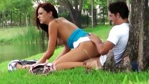 Red haired nice-looking playgirl is riding on a penis outside